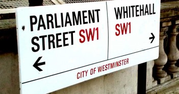 A sign pointing to Parliament Street and Whitehall