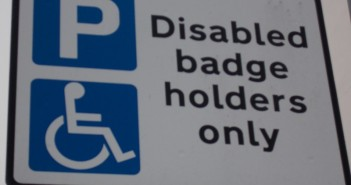 A blue badge parking sign