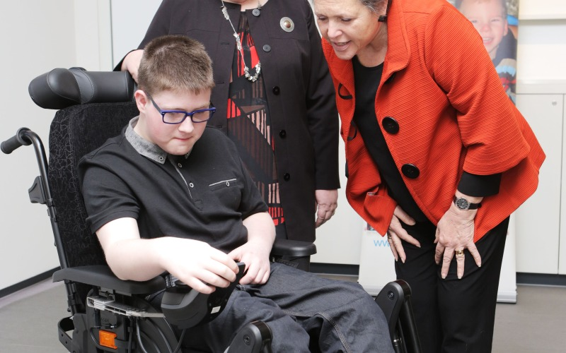 Christopher Anderson showing Baroness Kramer his new wheelchair