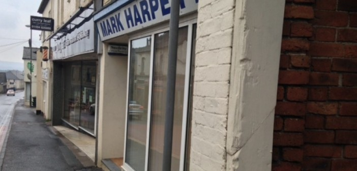 Entrance to Mark Harper's office, showing doorstep, windows and slope of the hill