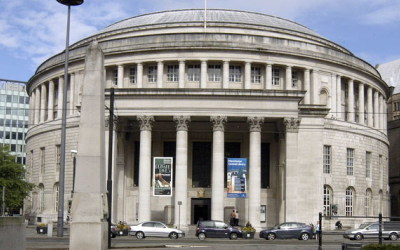 Manchester central library with cars parked in front