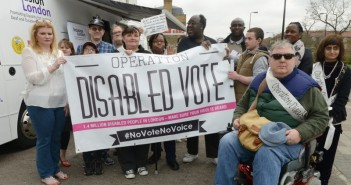 A group of campaigners from Operation Disabled Vote holding a poster advertising the campaign