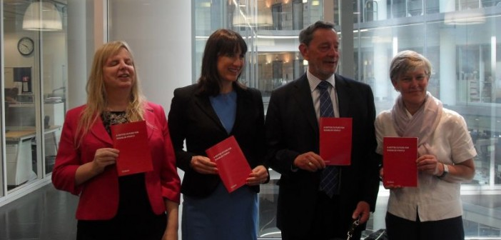 Emily Brothers, Rachel Reeves, David Blunkett and Kate Green holding copies of the disability manifesto