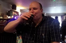 Doug Paulley drinking a pint of beer