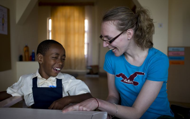 Sophie Christiansen with a disabled child in Rwanda