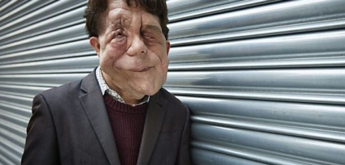 Adam Pearson, leaning against a fence