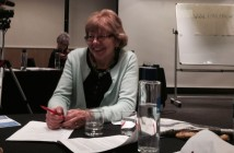 Jenny Morris sitting at a table in a conference