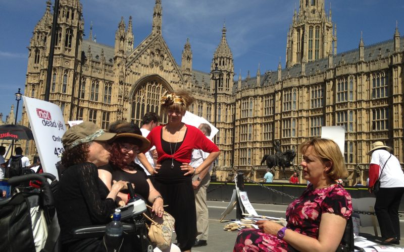 Liz Carr talking to Penny Pepper and Tanni-Grey-Thompson outside the House of Lords