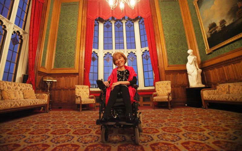 Baroness Campbell, in her wheelchair in the centre of a richly-decorated room