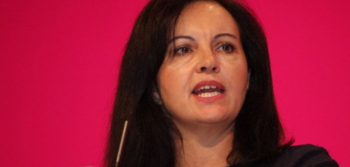 Head and shoulders of Caroline Flint speaking