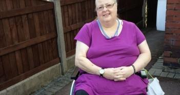 Jo Jones sitting in wheelchair