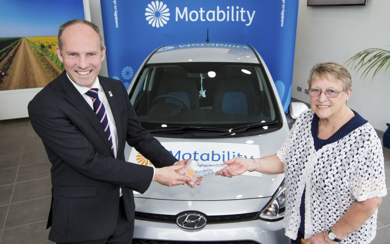 Juston Tomlinson hands over the leys to a Motability vehicle