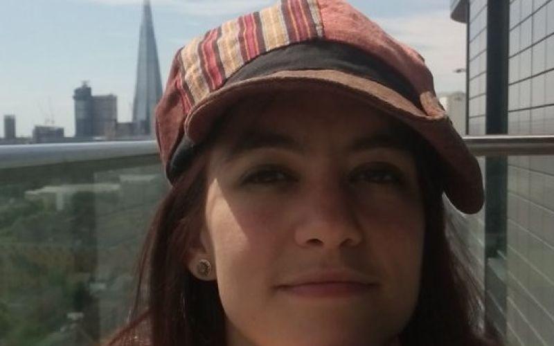 Head and shoulders of Marina Bernstein, wearing a cap