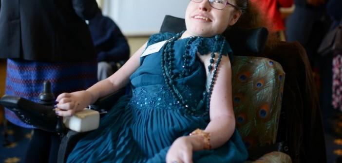 Fleur Perry wearing a blue dress