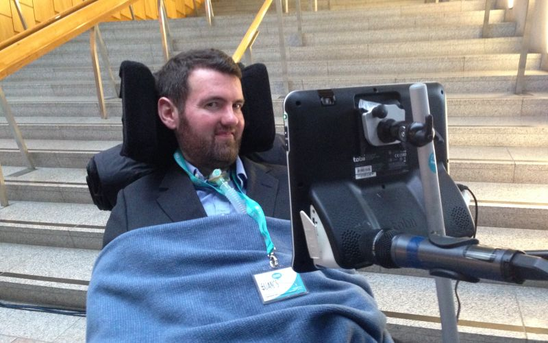 Euan MacDonald in his wheelchair at the foot of a flight of steps
