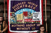 Tapestry featuring rights slogans such as Disabled People Fight Back and Nothing About Us Without Us