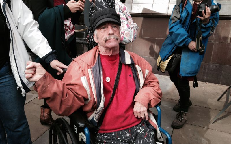 Bob Williams-Findlay in his wheelchair at a protest