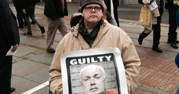 Brian Hilton, holding a poster of Iain Duncan Smith with the heading Guilty