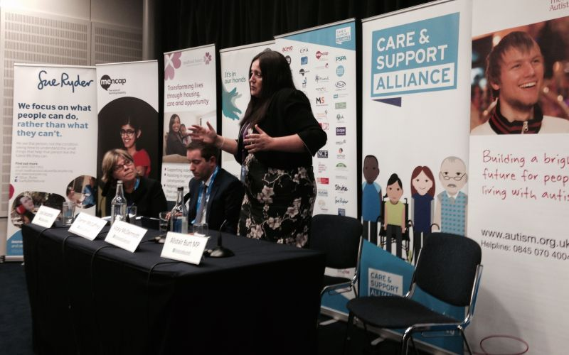 Vicky McDermott speaking to a meeting from behind a table