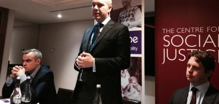 Justin Tomlinson speaking at a meeting