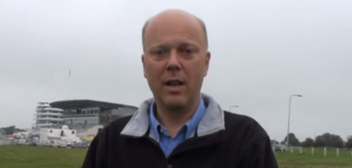 Head and shoulders of Chris Grayling talking