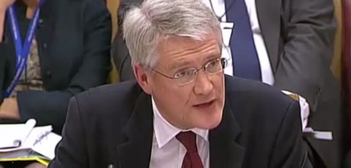 Head and shoullders of Andrew Jones giving evidence to the committee