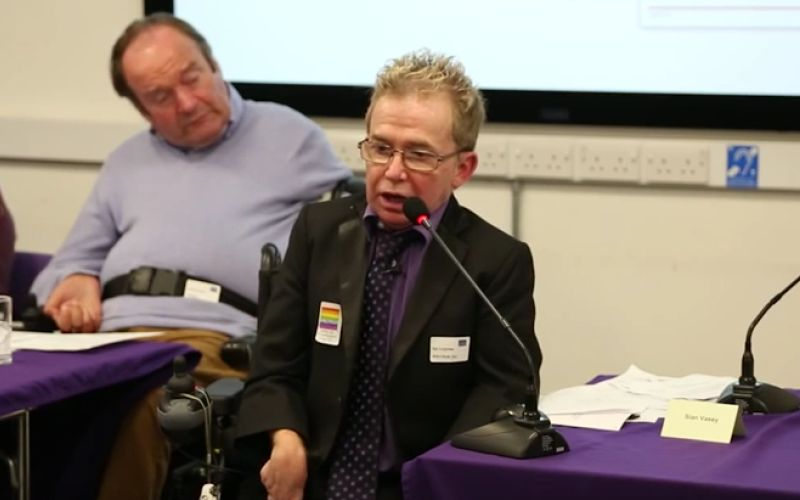 Ian Loynes speaking into a microphone
