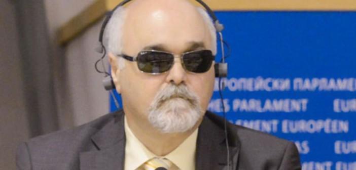 Head and shoulders of Yannis Vardakastanis, wearing headphones