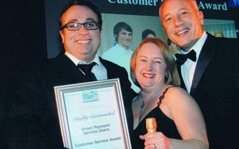Paul Co-Head and his wife accept an award