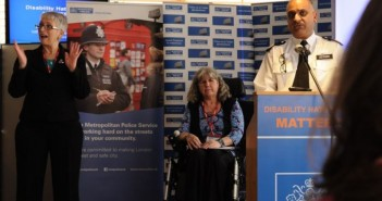 Anne Novis on stage beside commander Mak Chishty of the Met police