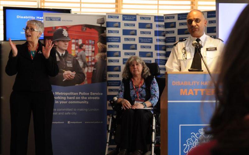 Anne Novis on stage beside commander Mak Chishty of the Met police
