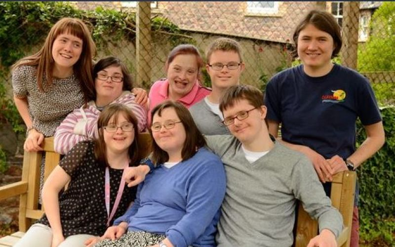 Some of the disabled people featured in The Special Needs Hotel grouped together in a garden
