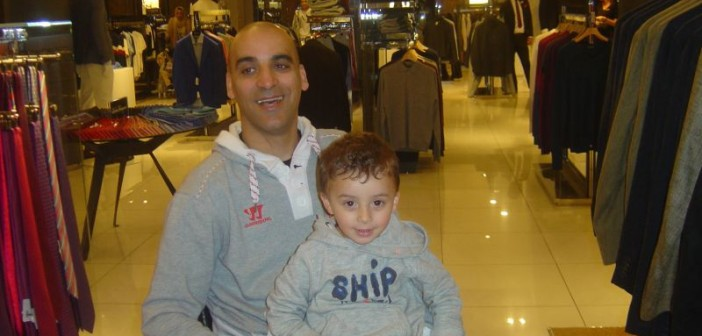 Youcef Bey-Zekkoub with his son Adam on his lap