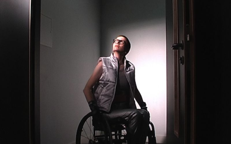 Ju Gosling sitting in her wheelchair