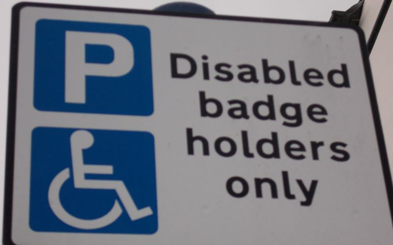 A sign saying disabled badge holders only