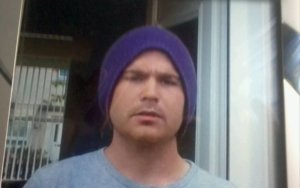 Head and shoulders of David Barr wearing a blue woollen hat