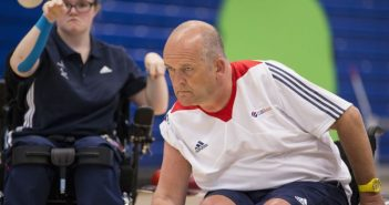 Nigel Murray throwing a boccia ball from his wheelchair