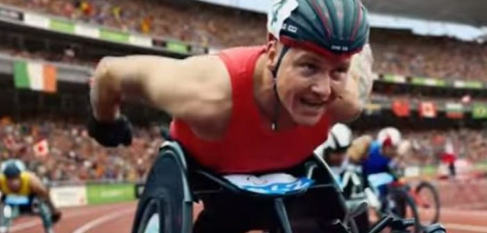 Wheelchair-racer David Weir racing round a bend on the track