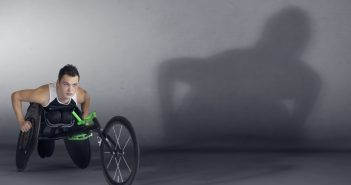 Ben Rowlings in his wheelchair, with his shadow on the wall behind him
