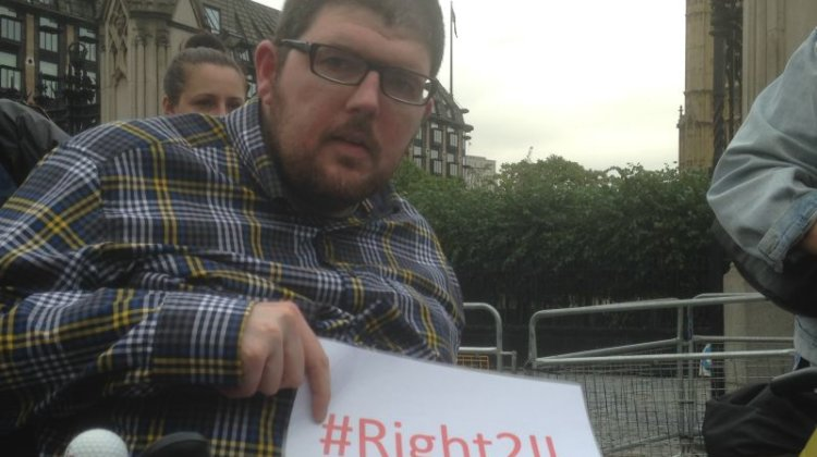 Disabled activist 'is fighting for his life' as he hands petition to Welsh government
