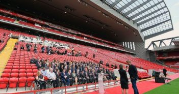 Guests sitting in the new Liverpool stand at its official opening