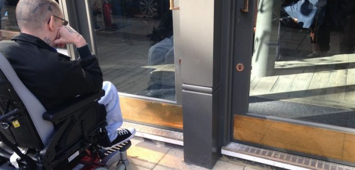 Sam Brackenbury staring at the step outside The Alchemist from his wheelchair