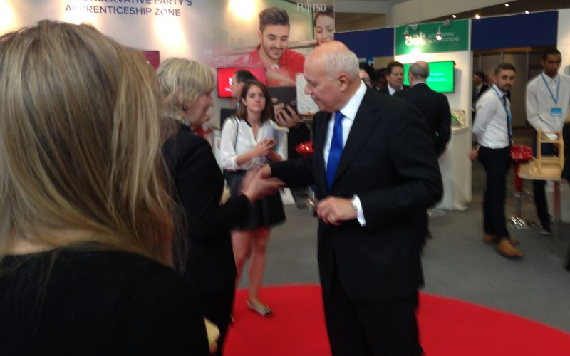 Iain Duncan Smith shaking hands with a woman