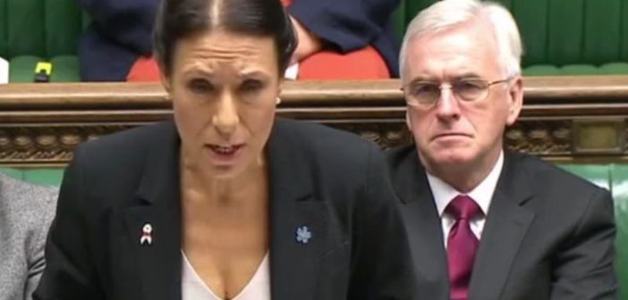 Debbie Abrahams speaking in parliament, with John McDonnell sitting behind her