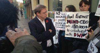 Paul Farmer speaking to protesters outside Mind's headquarters