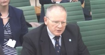 Larry Gardiner giving evidence to the committee