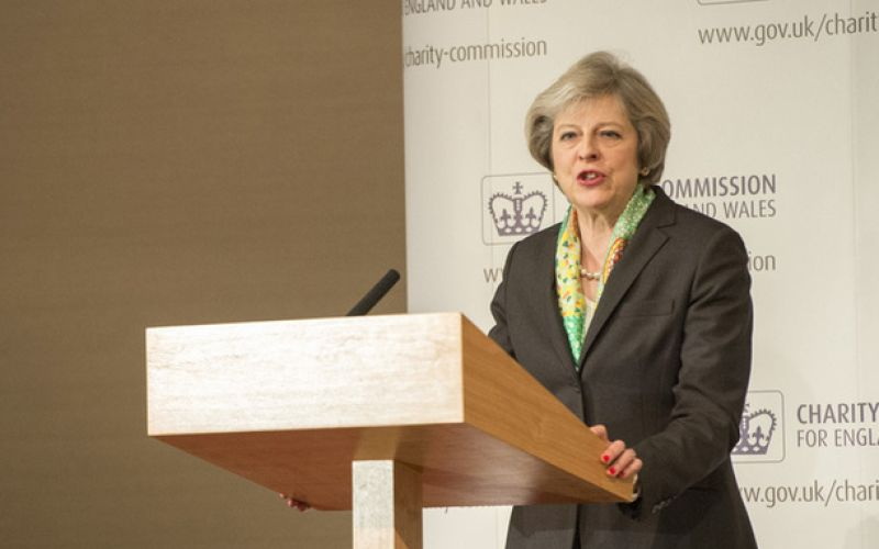 Theresa May speaking at a lectern