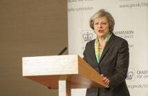 Theresa May speaking at a lectern