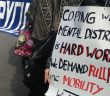 Placard at protest saying: Coping with mental distress is hard work. We demand full PIP including mobility