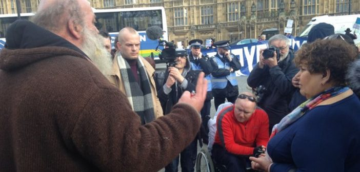 Marie Rimmer talks to Roy Bard, surrounded by police officers, cameras and protesters